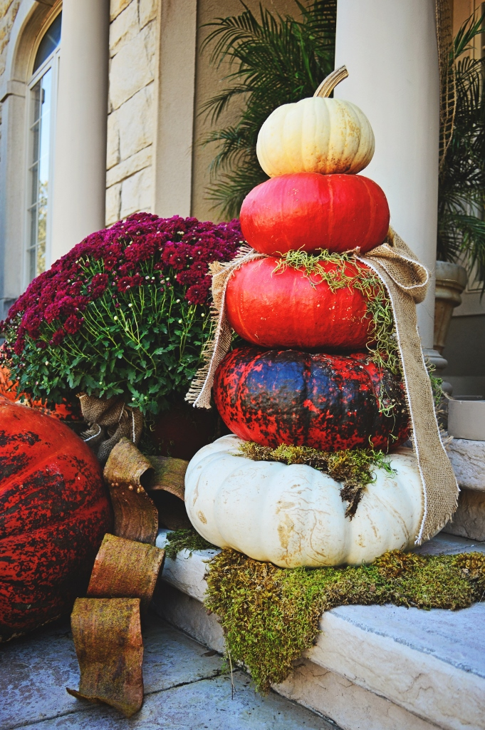 Moss and ribbon add interest, and balance (literally) to your pumpkin stacks. Try tucking a few strands of ribbon under your pumpkins to help add stability and keep your pumpkins from toppling. Moss works great for this too. But keep in mind, dyed moss will fade in the sun.